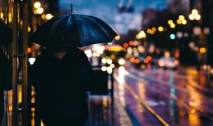Image of person holding umbrella